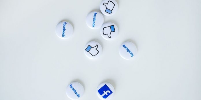 A photo of Facebook logo and badges