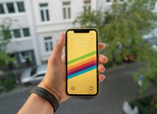 A person holding an iPhone XR in yellow