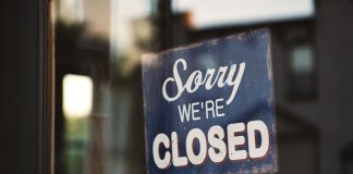 A photo of a small business closed door due to coronavirus outbreak