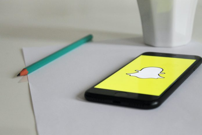 A phone with Snapchat logo on a table